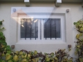 Schilderwerk tralies voor raam